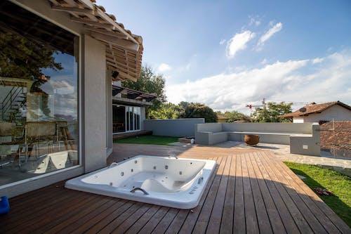 Terrace of villa with bathtub in tropical resort