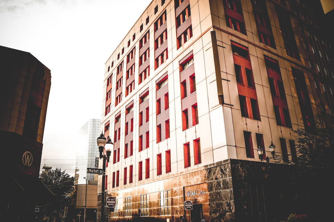 Beige and Red Building Under Cloudy Sky