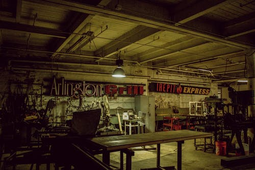 Old empty workshop with furniture and lamp