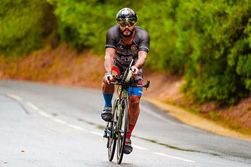 Concentrated sportsman on bicycle in daylight