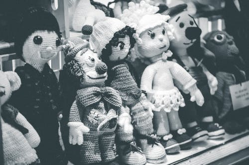 Collection of various knitted toys in store