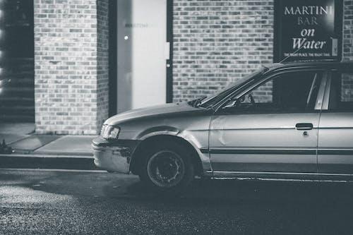 Car parked near brick wall