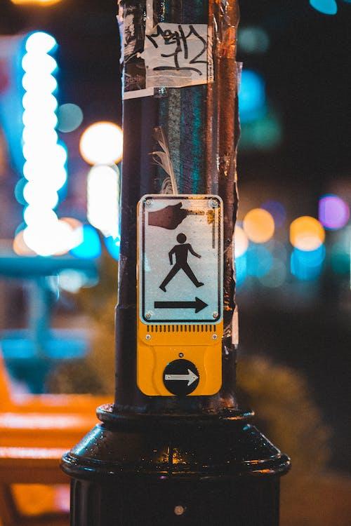 Pedestrian crossing call button in street