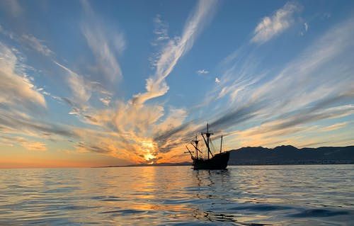 Silhouette of a Pirate Ship Sailing on Sea during Golden Hour