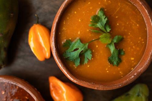 Orange Soup Dalam Brown Ceramic Bowl