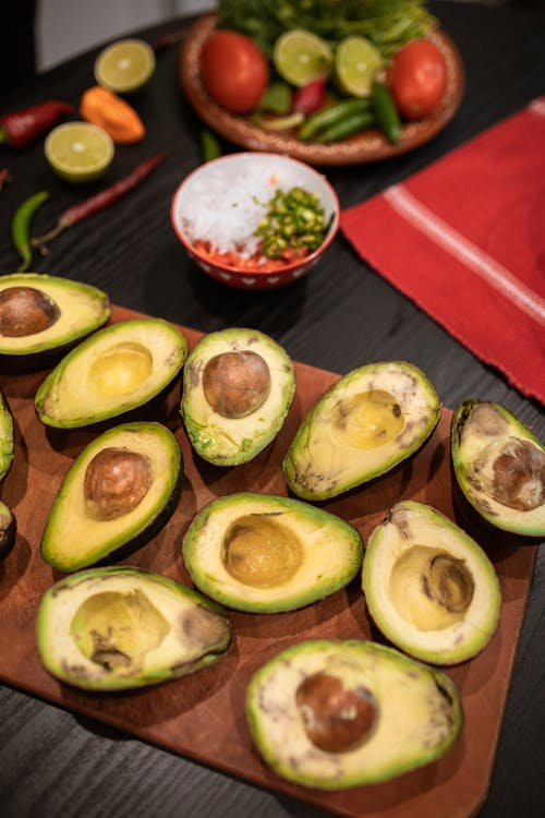 Sliced Avocado Fruit on Red Table