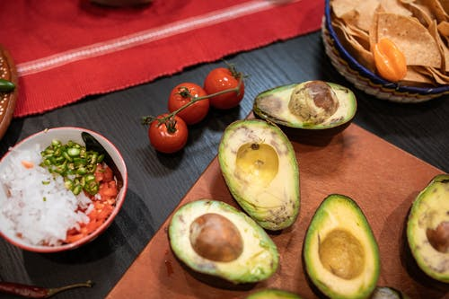 Sliced Avocado Fruit on Red Ceramic Plate