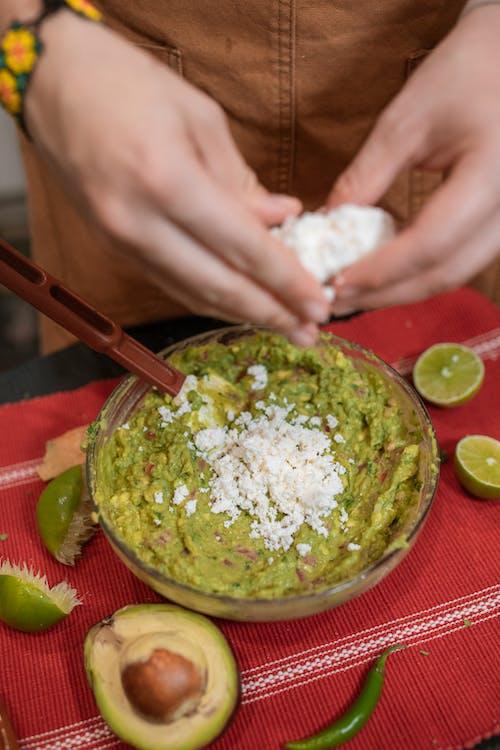 Person Making Guacamole