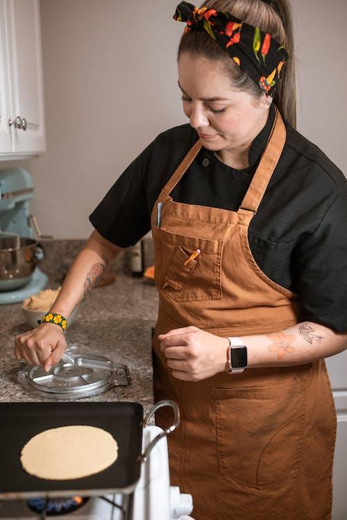 A Female Chef Making Tortilla