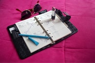 sunglasses, notebook, calendar