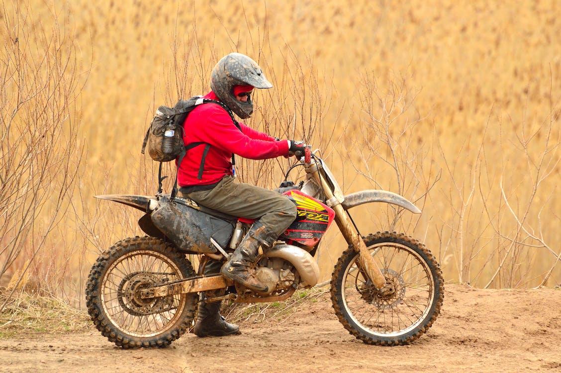 Man in Red Sweater Driving Dirt Bike
