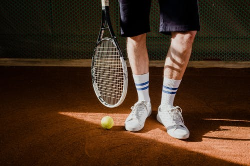 Man in White Socks and White Socks Holding Tennis Racket