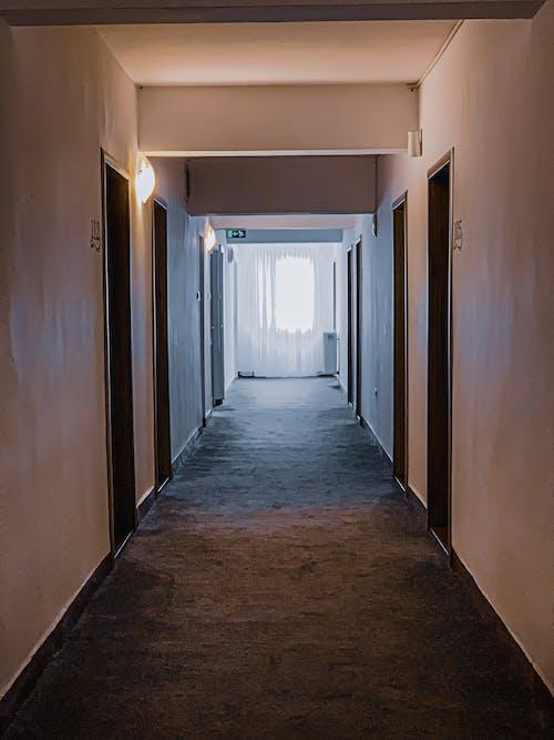 Narrow illuminated hallway in building