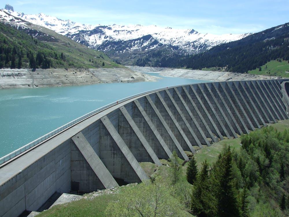 Gray Dam Under Blue Sky