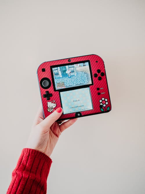 Person Holding Red and White Nintendo Switch