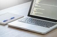 laptop, notebook, pen