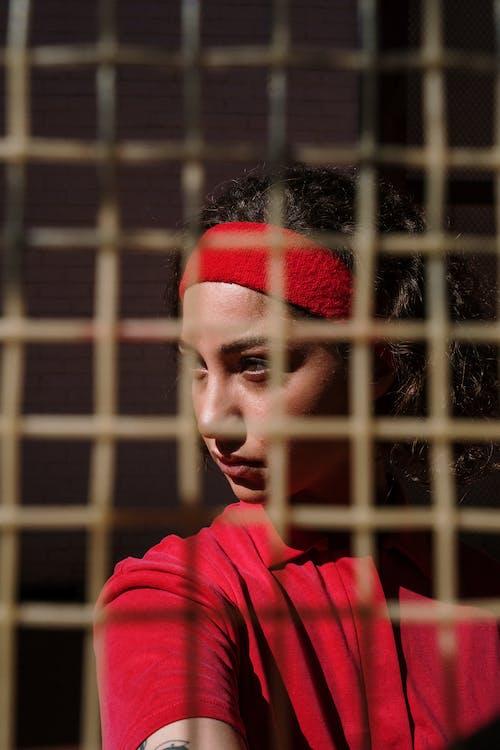 Woman in Red Hoodie Wearing Red Knit Cap