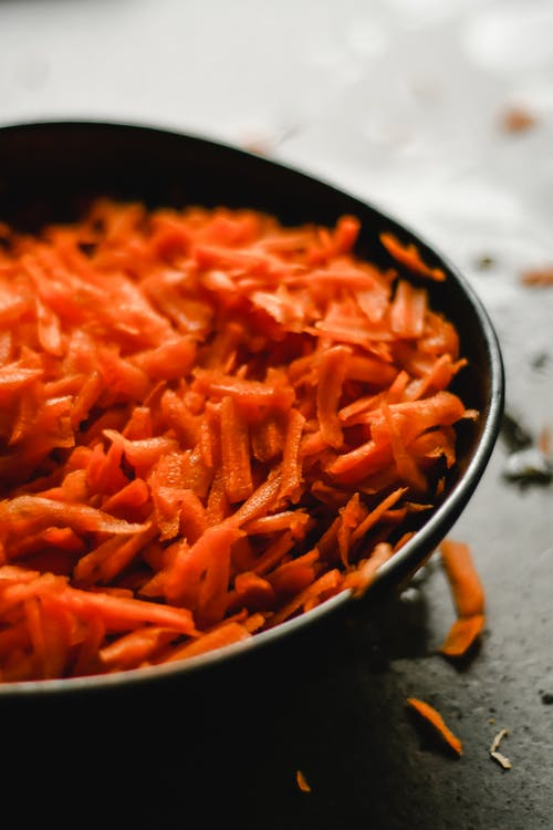Fresh carrot prepared for cooking in pan