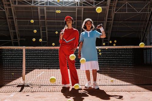 Man in Blue Polo Shirt Holding Tennis Racket