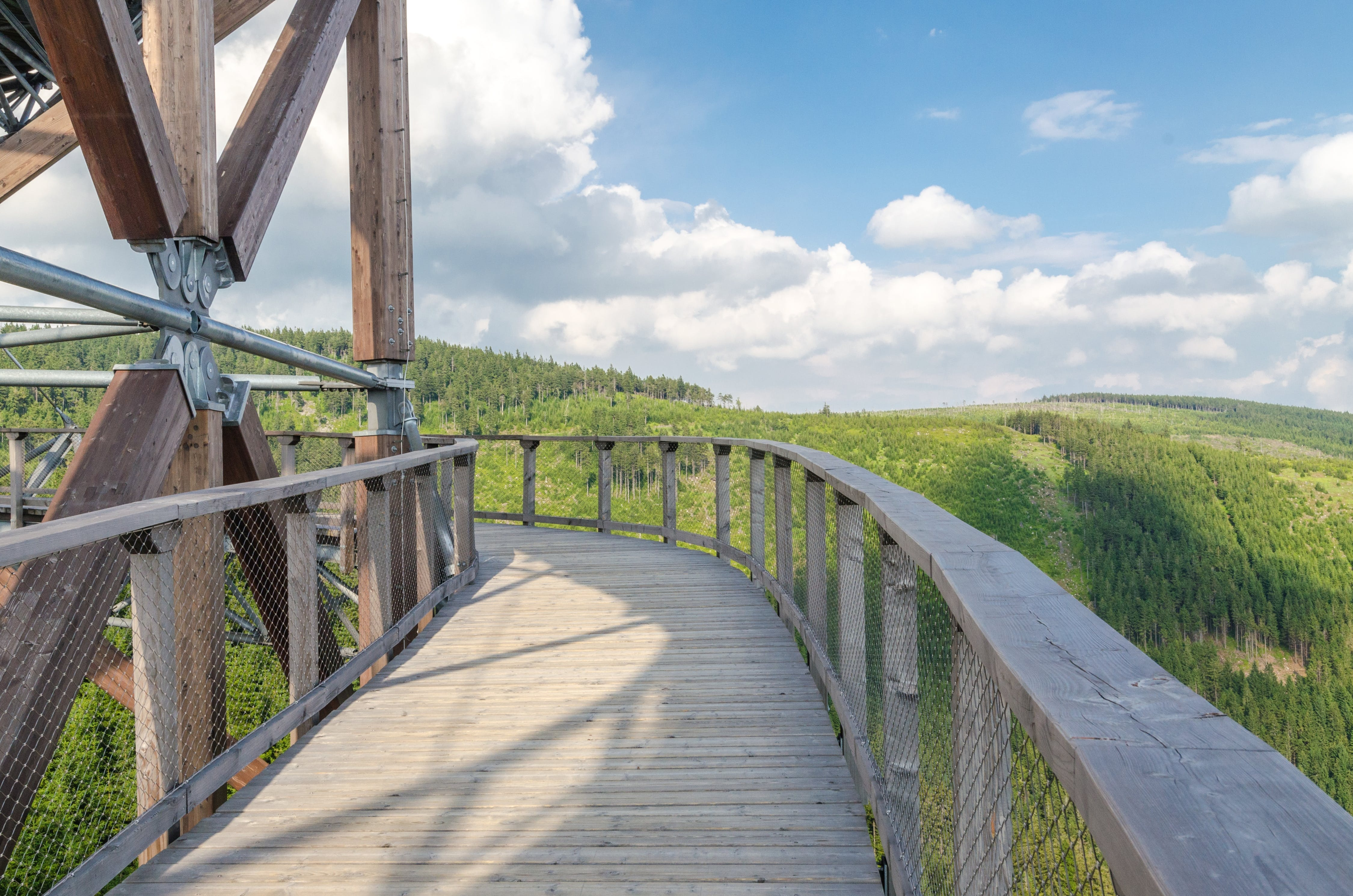 Brown Wooden Bridge Under Blue Sky