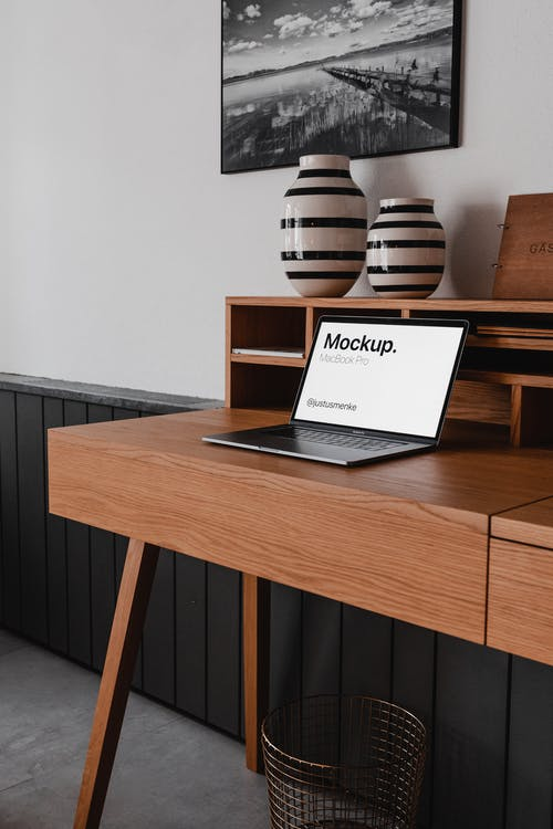 Brown Wooden Desk With White Paper Document