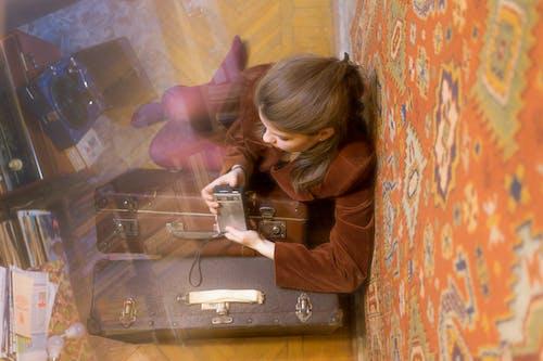 Woman sitting on floor in vintage room