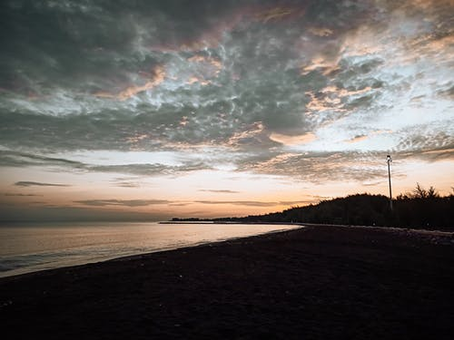 Seashore near sea at sunset time