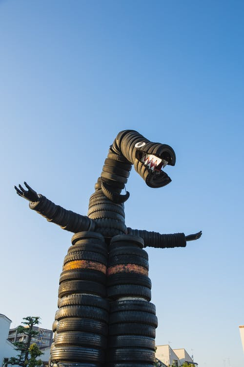 Dragon made of tyres in yard
