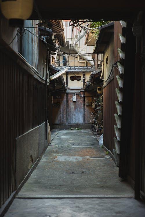 Narrow walkway between old residential buildings in town