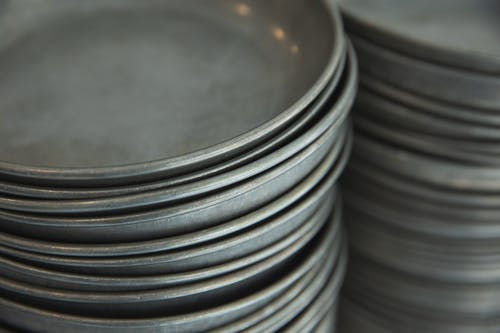 Collection of metal plates on surface