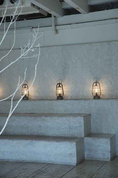 Cozy room with concrete walls and glowing lamps