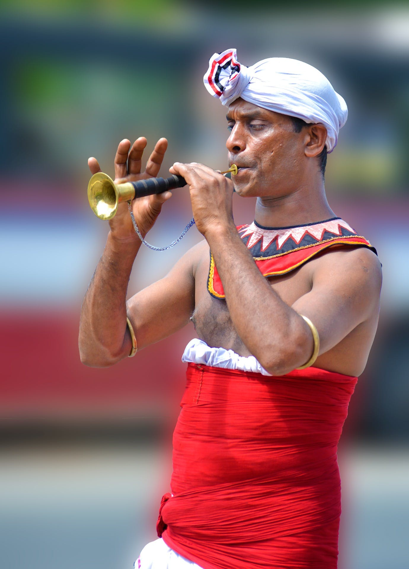 Man Playing Brass Instrument during Daytime