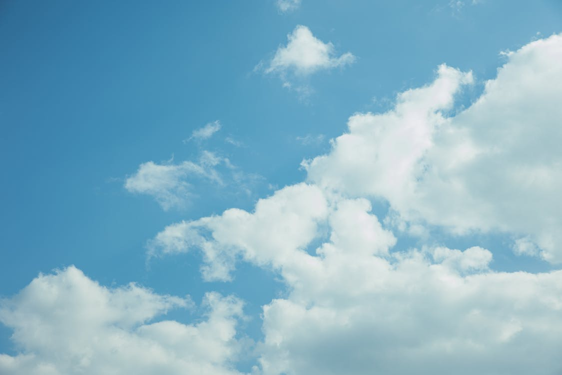 Thick clouds in bright blue sky