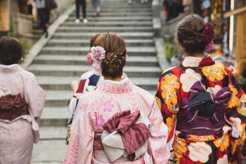 Anonymous women in traditional apparel in city