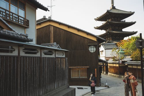 Japanese women taking selfie on authentic street with Asian pagoda