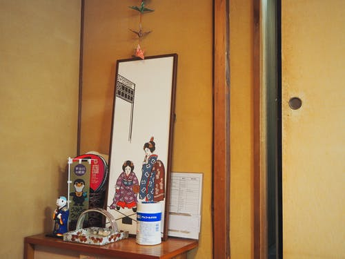 Traditional Japanese souvenirs placed on wooden table