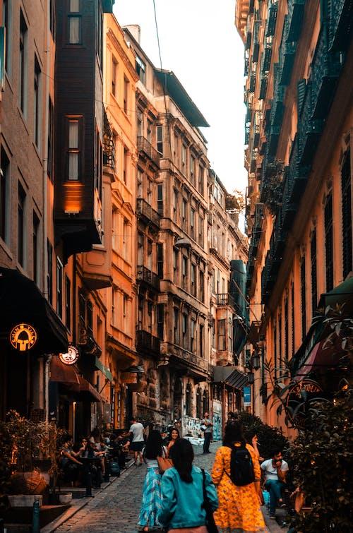 People strolling on narrow street