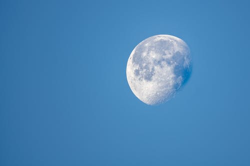 Luminous moon on blue starless sky