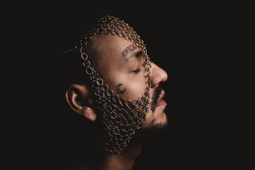 Man in Silver Chain Link Chain