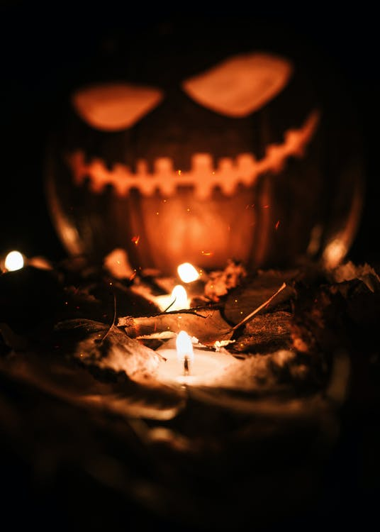 Jack O Lantern With Lighted Candles