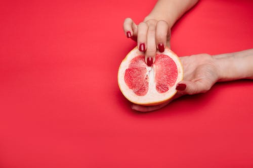 Sliced Lemon on Persons Hand