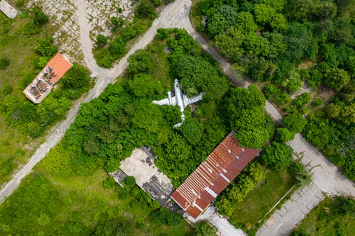 Aerial View of Green Trees and Brown House