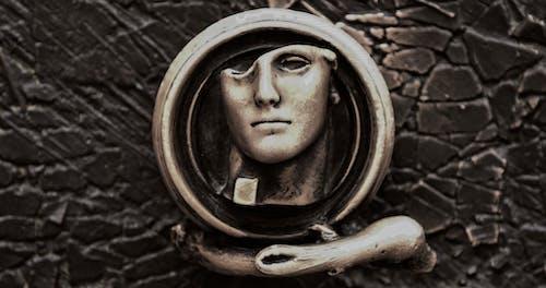 Foto profissional grátis de escultura, maçaneta
