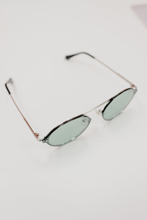 From above of contemporary sunglasses with lenses placed on white table in optical shop
