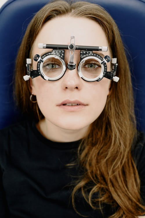 Serious woman in lenses in clinic