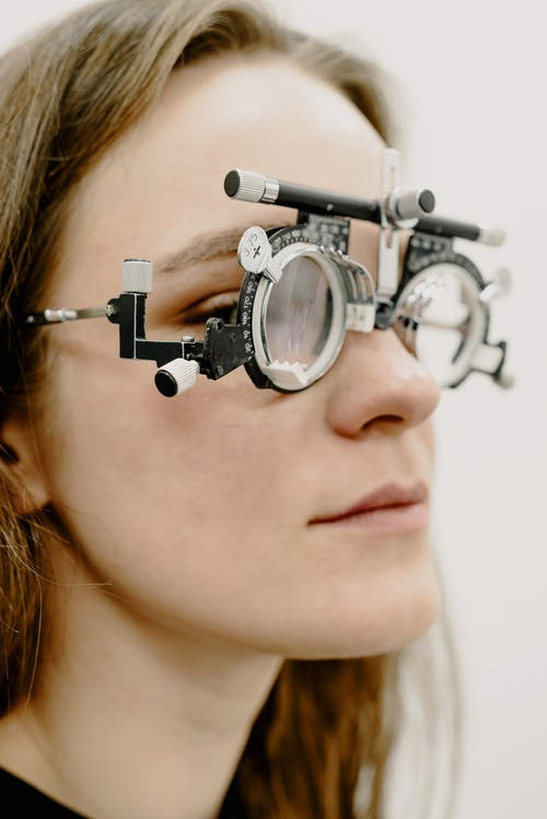 Woman checking vision in medical glasses