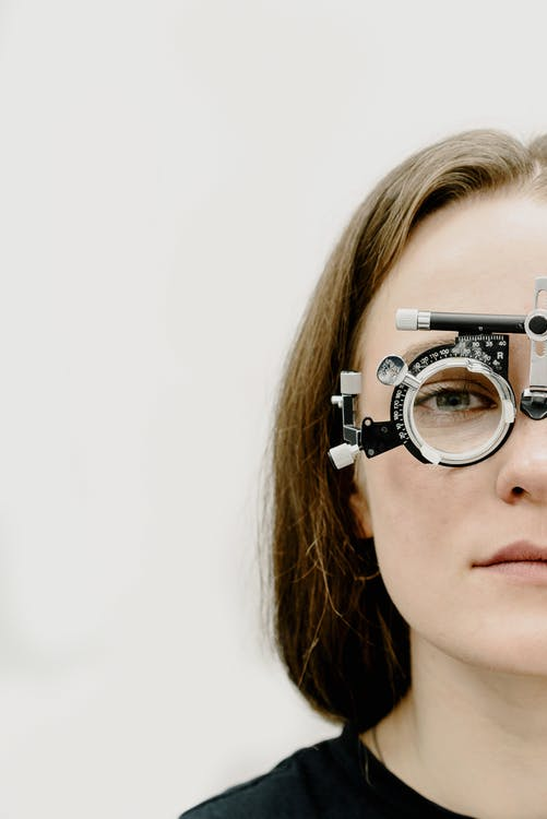Woman in rim with trial lens in ophthalmology clinic