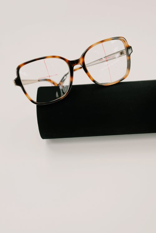 Stylish eyeglasses with ornamental frame on case
