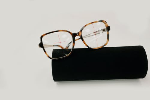 Trendy eyeglasses with spots on black case