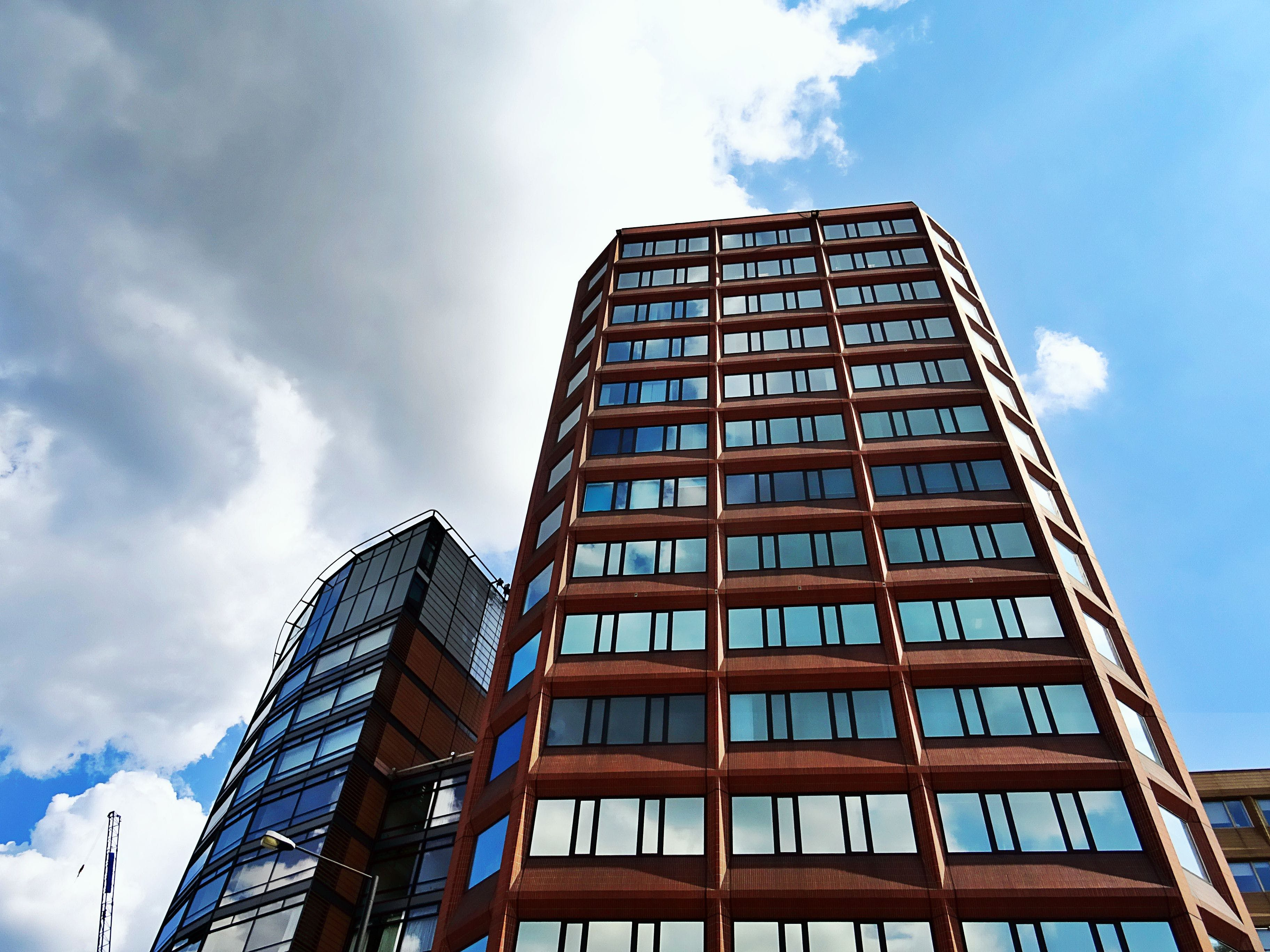 Low Angle Photography of Brown Concrete Building Under Blue Sky